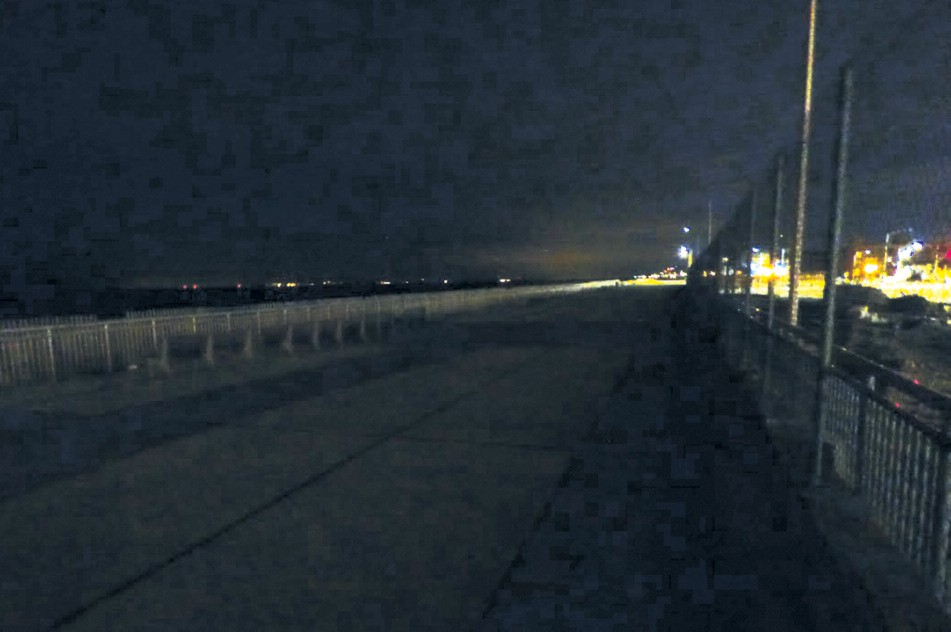 The Boardwalk Is Completely Enveloped By Darkness Between Beach 105th And 108th Streets With